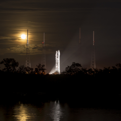 This photo provided by NASA shows a full moon rising behind the United Launch Alliance Atlas V rocket with NASAs Mars Atmosphere and Volatile Evolution (MAVEN) spacecraft onboard at the Cape Canav ...
