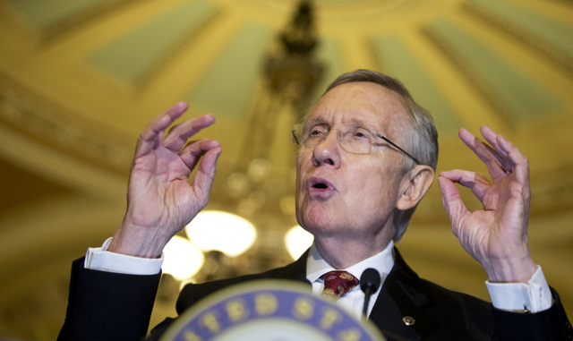Senate Majority Leader Sen. Harry Reid, D-Nev., speaks to the media on Capitol Hill in Washington, Tuesday, Nov. 19, 2013. (AP Photo/Manuel Balce Ceneta)