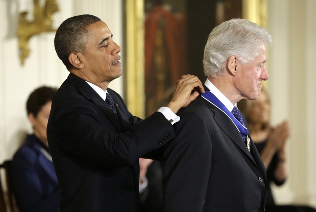 President Barack Obama awards former President Bill Clinton the Presidential Medal of Freedom on Wednesday during a ceremony in the East Room of the White House. (AP Photo/Pablo Martinez Monsivais)