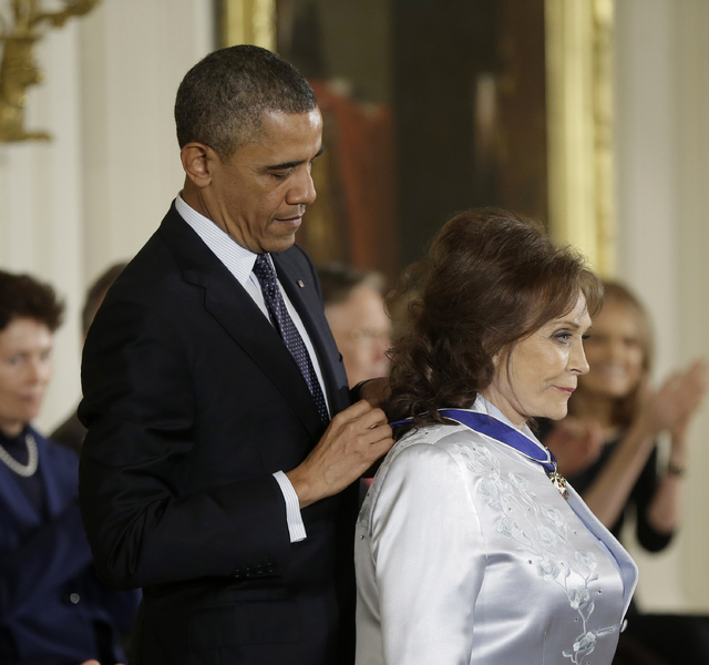 President Barack Obama awards country music legend Loretta Lynn the Presidential Medal of Freedom in a ceremony on Wednesday at the White House. (AP Photo/Pablo Martinez Monsivais)