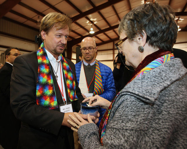 The Rev. Frank Schaefer, left, of Lebanon Pa., celebrates communion with supporters after the sentencing phase of the trial at Camp Innabah, a United Methodist retreat, in Spring City Pa. Tuesday  ...