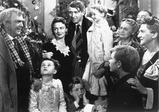"Legendary actor James Stewart as George Bailey, center, is reunited with his wife, played by actress Donna Reed, and family during the last scene of Frank Capra's ""It's A Wonderful Life."" (AP Phot ..."