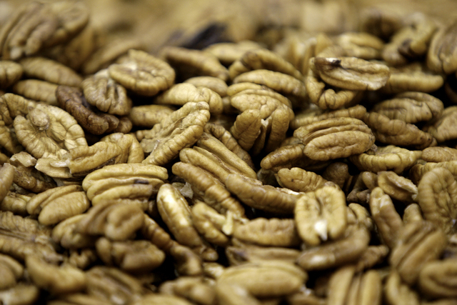 This Nov. 21, 2008 file photo shows shelled pecans at the Navarro Pecan Company in Corsicana, Texas. Help yourself to some nuts this holiday season: Regular nut eaters were less likely to die of c ...