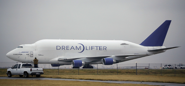 A man takes a photo of the Boeing 747 LCF Dreamlifter from the back of his truck on Thursday after the aircraft accidentally landed at Col. James Jabara Airport in Wichita, Kan. Wednesday night. B ...
