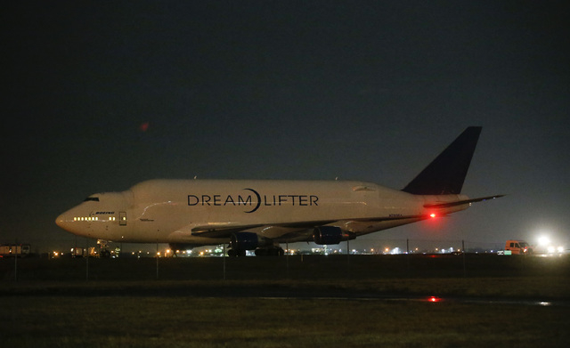 A Boeing 747 LCF Dreamliftersits on the runway after accidentally landing at Jabara airport in Wichita, Kan., Wednesday night. The pilots thought they were was landing at McConnell Air Force Base, ...