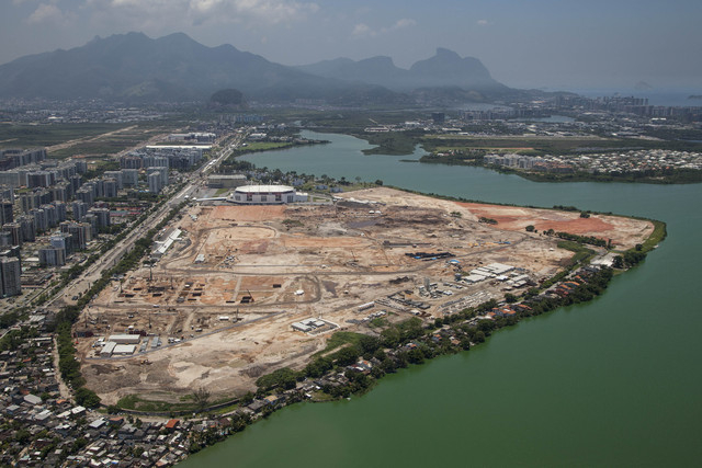 Polluted water surrounds the site of the Olympic Park as it is built in Rio de Janeiro, Brazil, Tuesday, Nov. 19, 2013. Nearly 70 percent of the citys sewage goes untreated, meaning runoff from Ri ...