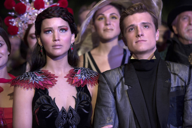 "This image released by Lionsgate shows Jennifer Lawrence as Katniss Everdeen, left, and Josh Hutcherson as Peeta Mellark in a scene from ""The Hunger Games: Catching Fire."" The film relea ..."