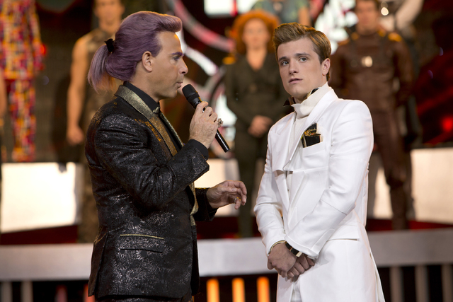 "This image released by Lionsgate shows Stanley Tucci as Caesar Flickerman, left, and Josh Hutcherson as Peeta Mellark in a scene from ""The Hunger Games: Catching Fire."" (AP Photo/Lionsga ..."