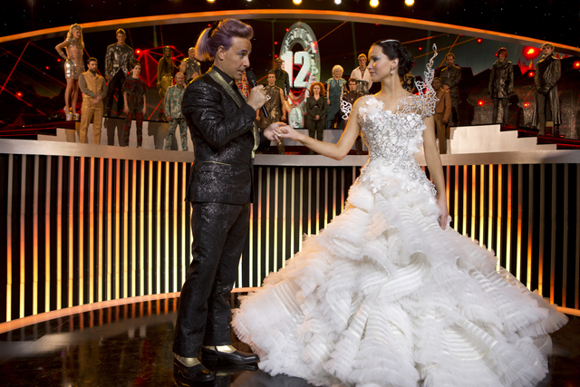 "This image released by Lionsgate shows Stanley Tucci as Caesar Flickerman, left, and Jennifer Lawrence as Katniss Everdeen in a scene from ""The Hunger Games: Catching Fire."" The film rel ..."