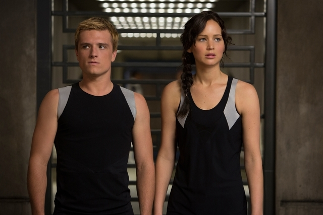 "This image released by Lionsgate shows Josh Hutcherson as Peeta Mellark, left, and Jennifer Lawrence as Katniss Everdeen in a scene from ""The Hunger Games: Catching Fire."" (AP Photo/Lion ..."