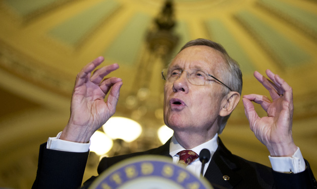 Sen. Harry Reid, D-Nev., speaks to the media on Capitol Hill on Tuesday. The Senate Majority Leader led a move in the Senate Thursday to undercut filibuster rules on presidential appointees. The S ...