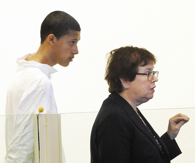 FILE - In this Oct. 23, 2013, file photo, Philip Chism, 14, stands during his arraignment for the death of Danvers High School teacher Colleen Ritzer, as his attorney Denise Regan speaks on his be ...