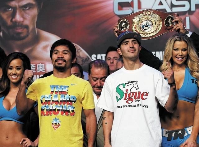 Manny Pacquiao, left, and Brandon Rios attend a weigh-in Friday ahead of their welterweight bout tonight at the Venetian Macau's Cotai Arena. (AP Photo/Vincent Yu)