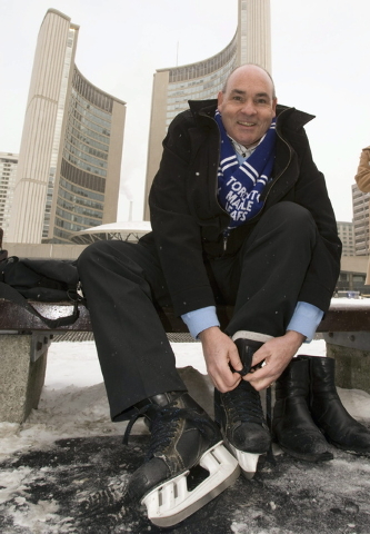 George Smitherman laces up his skates in front of City Hall after registering to be a candidate in the Toronto mayoral race in Toronto. Smitherman, an openly gay liberal who overcame an admitted h ...
