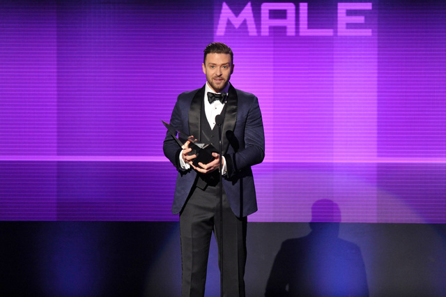 Justin Timberlake accepts the award for favorite male artist - pop/rock at the American Music Awards at the Nokia Theatre L.A. Live on Sunday, Nov. 24, 2013, in Los Angeles. (Photo by John Shearer ...