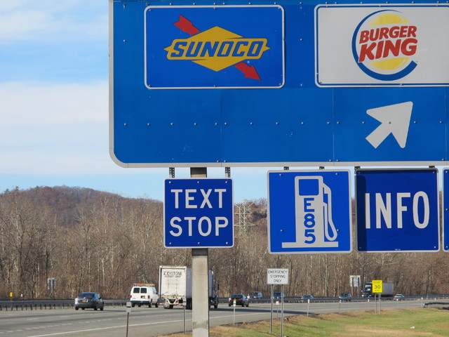 """A new """"text stop"""" notification is seen on a sign for a service area on the New York State Thruway in Sloatsburg, N.Y., on Thursday, Nov. 14, 2013. A state crackdown on texting while driv ..."""