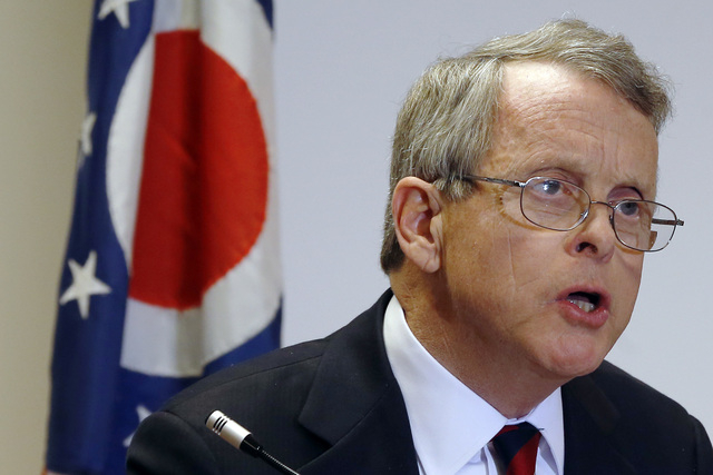 Ohio Attorney General Mike DeWine announces indictments against four additional people in relation to the 2012 rape of a high school student, on Monday, Nov. 25, 2013 in Steubenville, Ohio. The ch ...