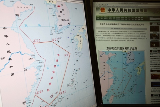 Computer screens display a map showing the outline of China's new air defense zone in the East China on the website of the Chinese Ministry of Defense, in Beijing Tuesday, Nov. 26, 2013. Beijing o ...