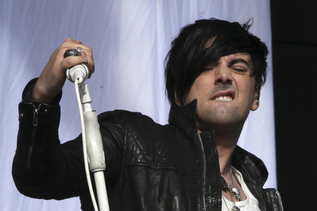 This is a Saturday, Aug 20, 2011 file photo of British musician Ian Watkins, lead singer of Lostprophets, as he  performs on stage at V Music Festival in Hylands Park, Chelmsford, England Watkins  ...