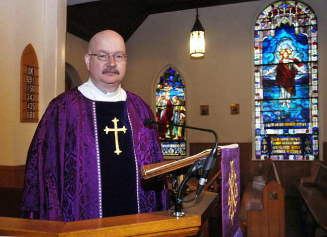 In this Tuesday, Feb. 23, 2010 photo, Father David Dingwall poses for a photo at Saint Paul's By The Sea Episcopal Church in Ocean City, Md. The Episcopal Diocese of Easton says Dingwall is one of ...