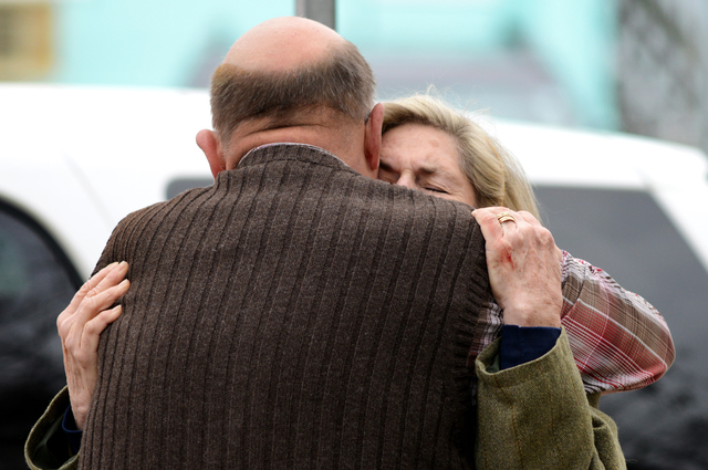 Diane Savage is consoled by Bruce Young in front St. Paul's By The Sea on Baltimore Avenue in Ocean City, Md., Tuesday, Nov. 26, 2013. Authorities say two people are dead and another suffered life ...