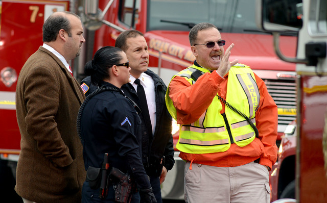 Ocean City Police Department Capt. Kevin Kirstein, right, speaks to Chief Ross Buzzuro and City Manager David Recor at the scene of a fire at St. Paul's By The Sea Episcopal Church, in Ocean City, ...