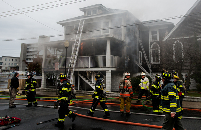 Ocean City firefighters work to extinguish a blaze in the rectory of St. Paul's By The Sea Episcopal Church, in Ocean City, Md., Tuesday, Nov. 26, 2013. Authorities say two people are dead and ano ...