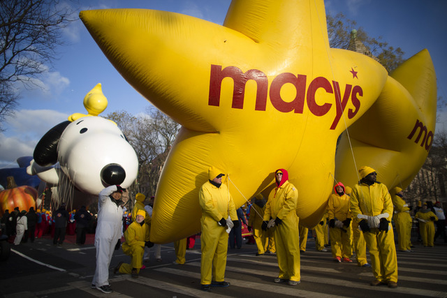 Balloon handlers wait before the 87th Annual Macy's Thanksgiving Day Parade on Thursday in New York. (AP Photo/John Minchillo)