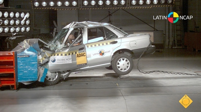 In this image taken from a March 2013 video released by independent crash-test group Latin NCAP on Nov. 27, 2013, a Nissan model Tsuru vehicle with no airbags is crash-tested at Latin NCAP's facil ...