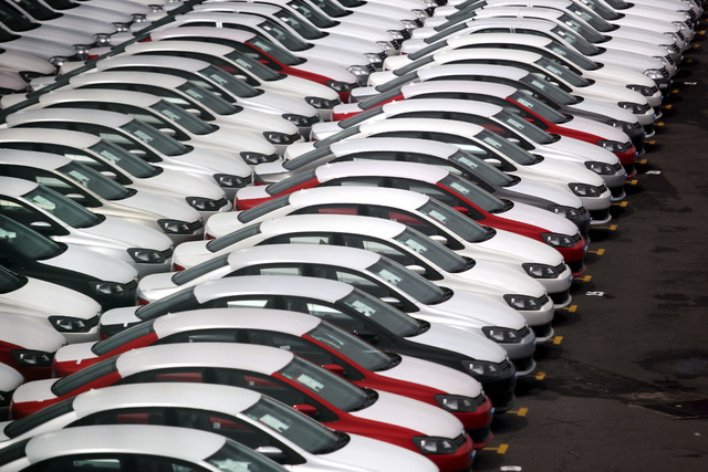 In this Sept. 19, 2013 photo, cars produced in Mexico for export are parked at the port terminal in the Gulf city of Veracruz, Mexico. Many international car manufacturers with plants in Mexico pr ...