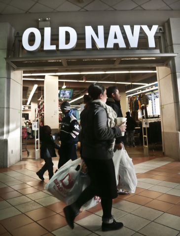 This Nov. 23, 2013 file photo shows shoppers approach Old Navy store at Atlantic Terminal Mall in New York.  Getting up early on Black Friday for a little shopping? Doing your part on Small Busine ...
