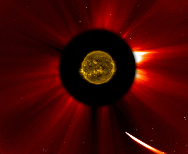 In a composite image provided by NASA, Comet ISON nears the sun in an image captured at 10:51 a.m. Eastern Standard Time on Thursday, Nov. 28, 2013. The sun was imaged by NASA's Solar Dynamics Obs ...