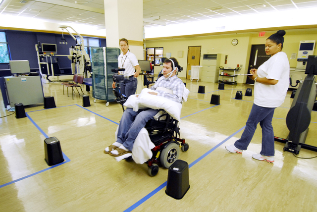 This undated handout photo provided by the Shepherd Center shows Jason DiSanto navigating an obstacle course in an electric-powered wheelchair by issuing commands with a magnetic tongue piercing.  ...