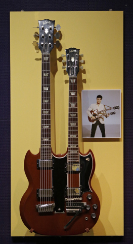 A rare Gibson double-necked guitar belonging to Elvis Presley hangs at the Rock and Roll Hall of Fame and Museum in Cleveland. (AP Photo/Mark Duncan)