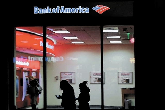Customers use a Bank of America ATM in June. SNL Financial recently released a report showing banks nationwide shut 390 branches in the third quarter, continuing a trend of consolidation for most  ...