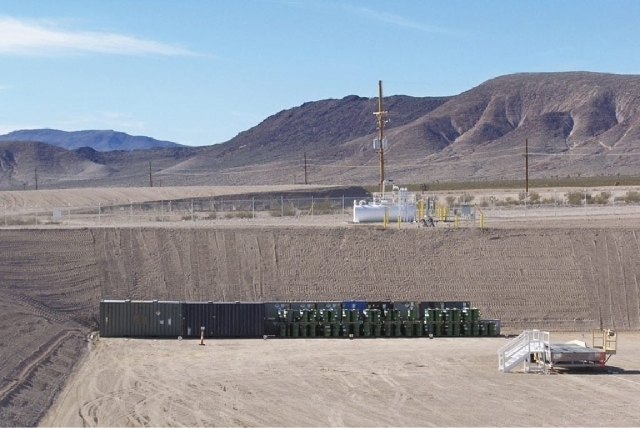 Waste packages are shown at the end of landfill cell in Area 5 at the Nevada National Security Site. (Courtesy Department of Energy, file)