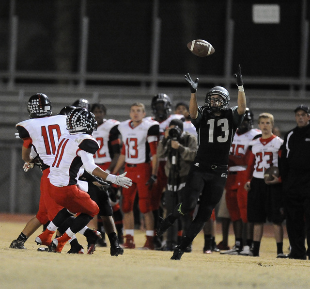 Green Valley Gators wide receiver Kyler Chavez (33) catches a Gators tipped ball in front of  Las Vegas Wildcats defensive back Aaron Zanin-Banks (11) in the second quarter at Green Valley High Sc ...