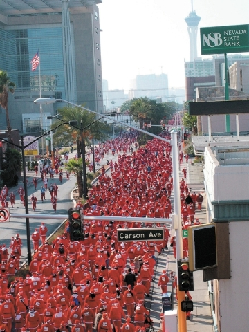 Thousands of Santas flood the streets of downtown Las Vegas during the Las Vegas Great Santa Run in December 2008. (F. Andrew Taylor/View file photo)