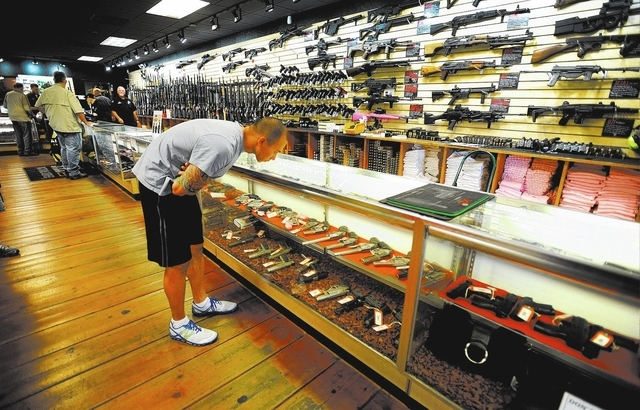A customer looks at a display case of hand guns at Discount Firearms and Ammo on Saturday, Oct. 26, 2013. (David Becker/Las Vegas Review-Journal)