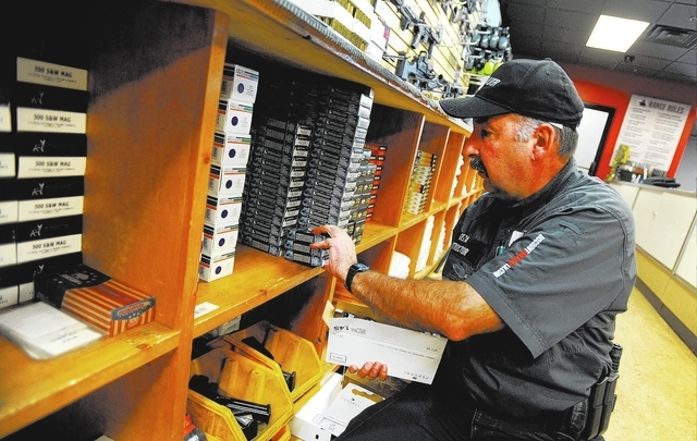 Store employee Geza Ohay restocks ammunition packages at Discount Firearms and Ammo on Saturday, Oct. 26, 2013. (David Becker/Las Vegas Review-Journal)