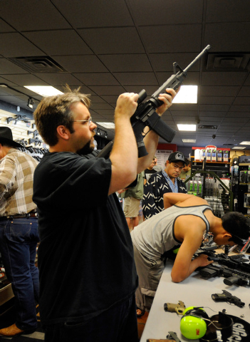 A customer who only gave his name as George, handles a Sig Sauer RM-400 tactical rifle at Discount Firearms and Ammo on Saturday, Oct. 26, 2013. (David Becker/Las Vegas Review-Journal)