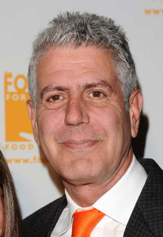 "Anthony Bourdain attends the Food Banks 'Can Do Awards' gala in New York. Bourdain's  new Travel Channel series, ""The Layover,"" premieres Monday at 9 p.m. EST. (AP Photo/Peter Kramer, file)"