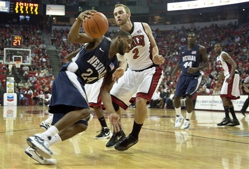 UNR guard Deonte Burton (24), shown during the Wolf Pack's 71-67 loss to UNLV on Nov. 14, 2011, is seventh on the Wolf Pack's career scoring list and is 40 points from fifth. (AP Photo/Julie J ...