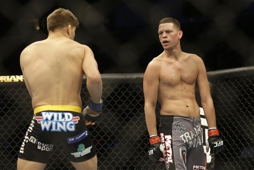 Nate Diaz, right, fights Josh Thomson in a UFC lightweight mixed martial arts fight in San Jose, Calif., Saturday, April 20, 2013. Thomson won by technical knock out in the second round. (AP Photo ...