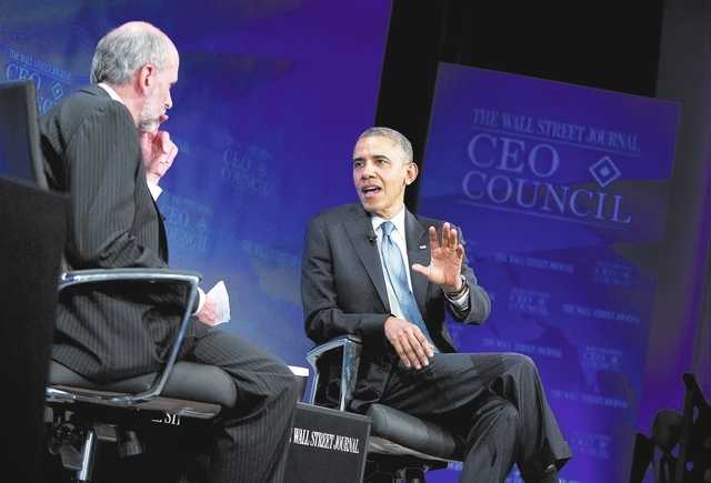 President Barack Obama answers a question from Wall Street Journal Washington bureau chief Gerald Seib during the Wall Street Journal CEO Council annual meeting in Washington on Tuesday. Obama ans ...