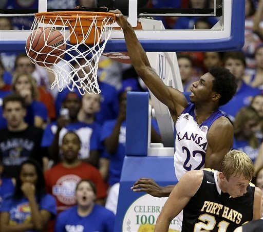 Kansas' Andrew Wiggins (22) gets past Fort Hays State's Jake Stoppel to dunk the ball during the second half of an exhibition NCAA college basketball game Tuesday, Nov. 5, 2013, in Lawrence, Kan.  ...