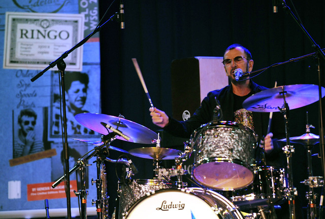 Ringo Starr performs behind the drum kit with his All Starr Band during a news conference at SIR studios on Oct. 23 in Los Angeles. (Chris Pizzello/Invision/AP)