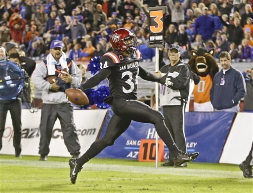 San Diego State defensive back J.J. Whittaker high steps his way into the end zone while scoring on a 18 yard interception return against Boise State on Nov. 23 in San Diego. San Diego State won t ...