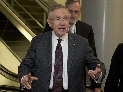 Senate Majority Leader Harry Reid of Nev., gestures as he talks to media as he walks on Capitol Hill in Washington, Wednesday, Nov. 13, 2013. (AP Photo/Carolyn Kaster)