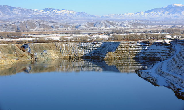 In this April 14, 2009 photo, the old Anaconda mine pit is partially filled with water near Yerington. Rural neighbors of an abandoned World War II-era copper mine that has leaked toxic chemicals  ...
